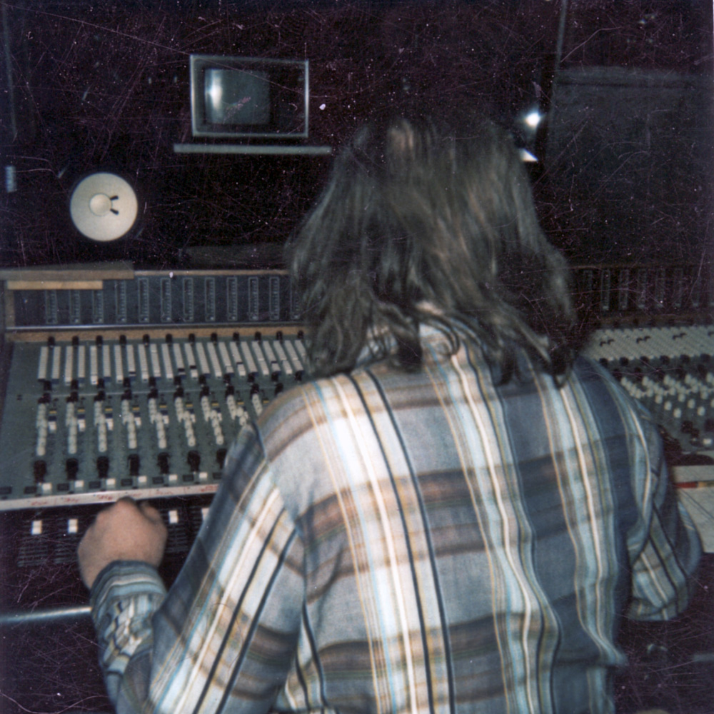 Dwight Marcus Glodell behind mixing board at PCI Studios.