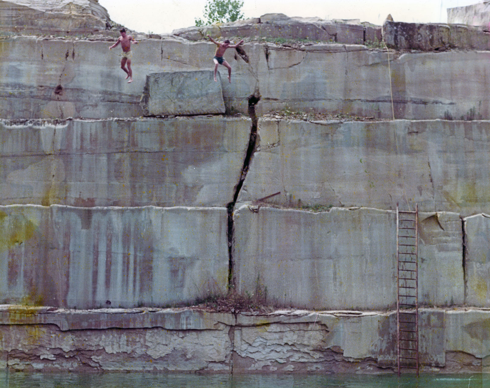 Fran and Paul Dodd jumping off rock in Bloomington Long Hole quarry