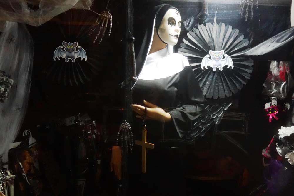 Nun costume in shop window on All Saints Day In Madrid
