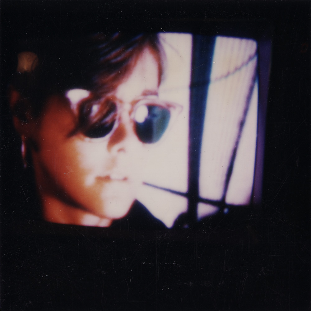 Polaroid stil by Duane Sherwood from Drifting Apart video.