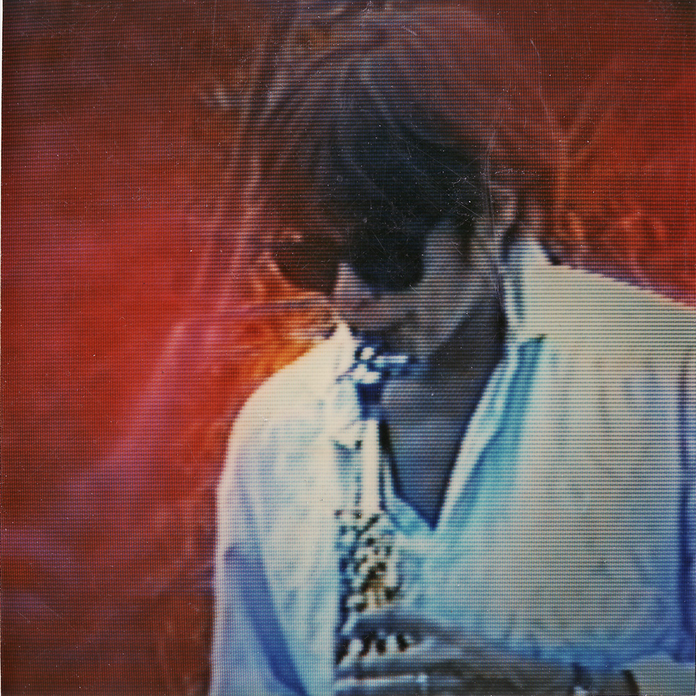 Peggi playing sax as seen on monitor, Duane Sherwood video.