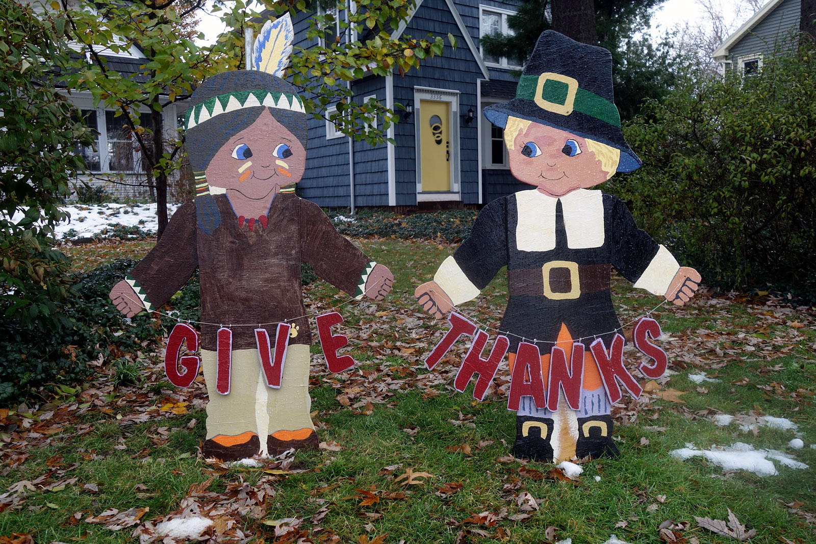 Wooden Thanksgiving figures on lawn in front of house on Culver Road