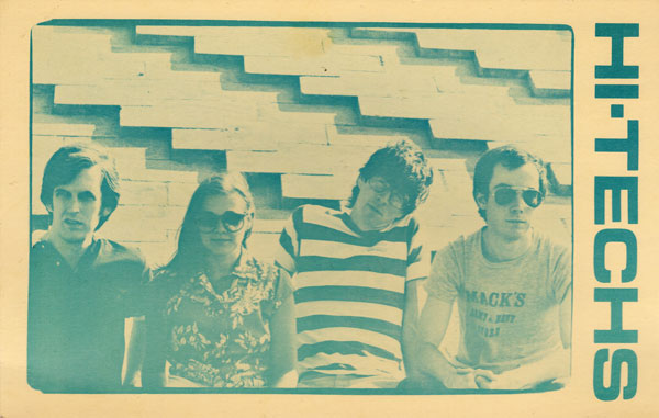 Promotion post card for Hi-Techs. Included in copies of their first 45 on Archive Records. L to R Ned Hoskin, Peggi Fournier, Paul Dodd and Martin Edic. Photo by Linnae Fisher. 1980