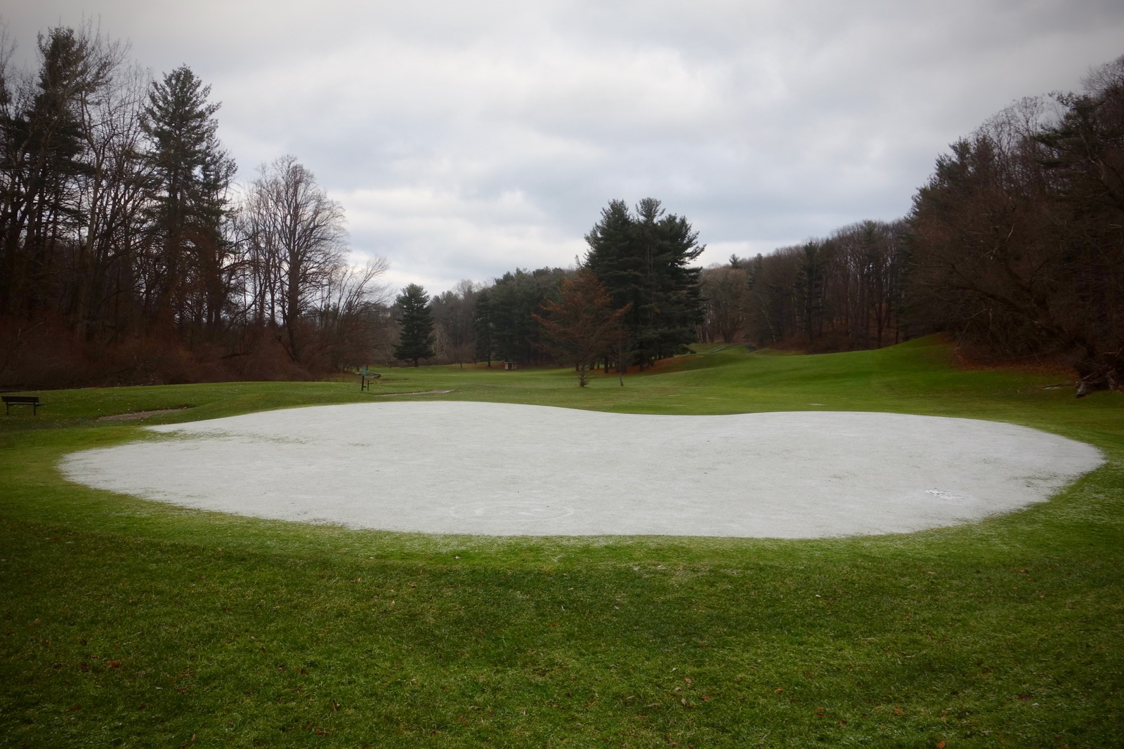 Snow covered green at Durand Eastman GolfCourse