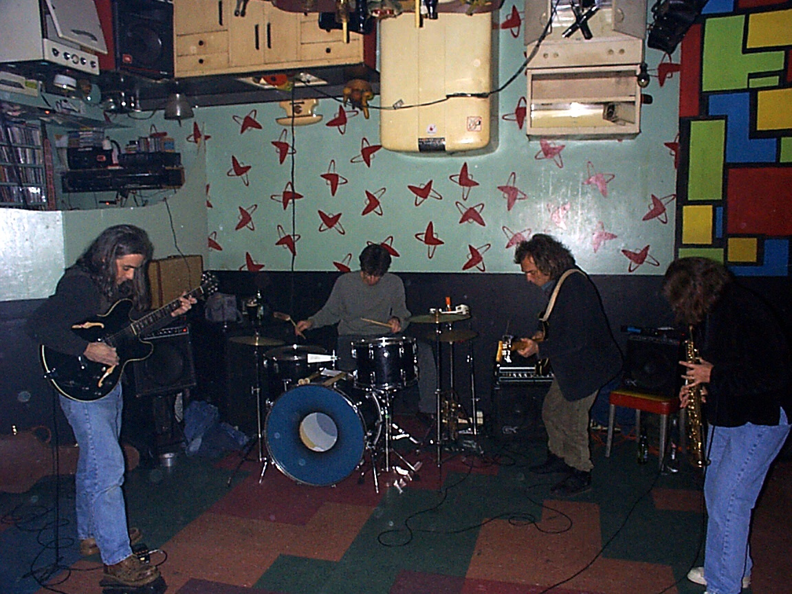 Margaret Explosion playing at Bug Jar Happy Hour in 1998. Jack Schaefer on guitar, Paul Dodd on drums. Pete LaBonne on bas guitar and Peggi Fournier on soprano sax.