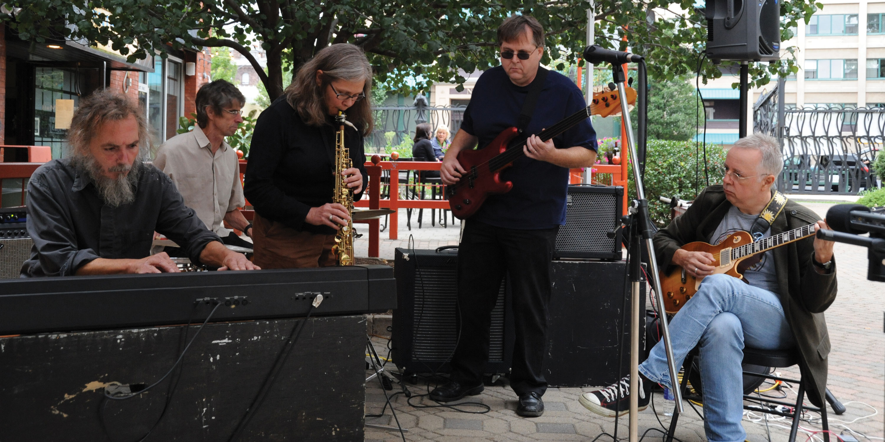 Margaret Explosion with Pete LaBonne performing live at Village Gate courtyard. Photo by Brian Peterson.