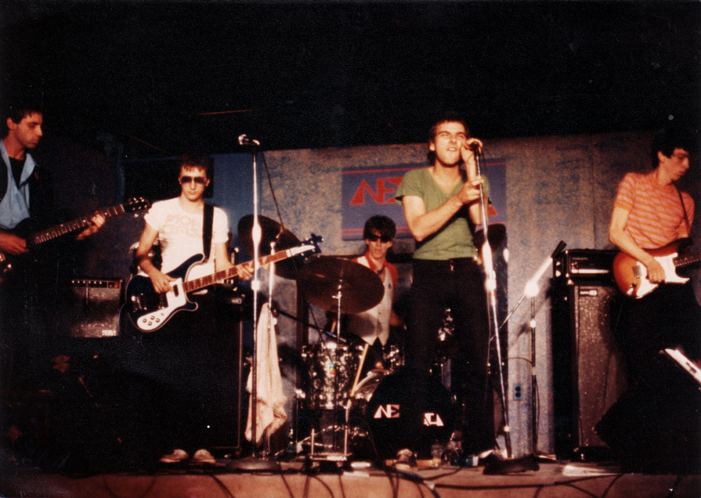 New Math performing at the Orange Monkey in 1977. Robert Slide - bass, Gary Trainer - guitar, Paul Dodd - drums, Kevin Patrick - vocals, Dale Mincey - guitar