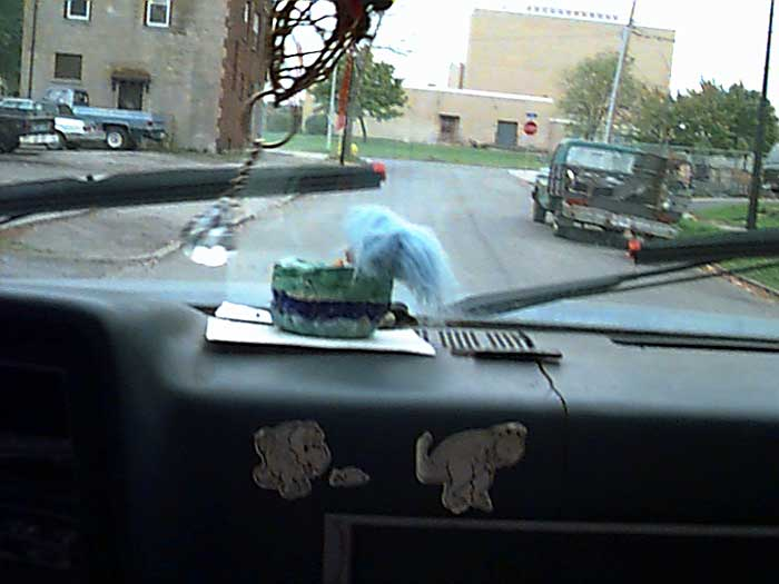Dashboard of Sparky's truck as we drive down Hall Street.