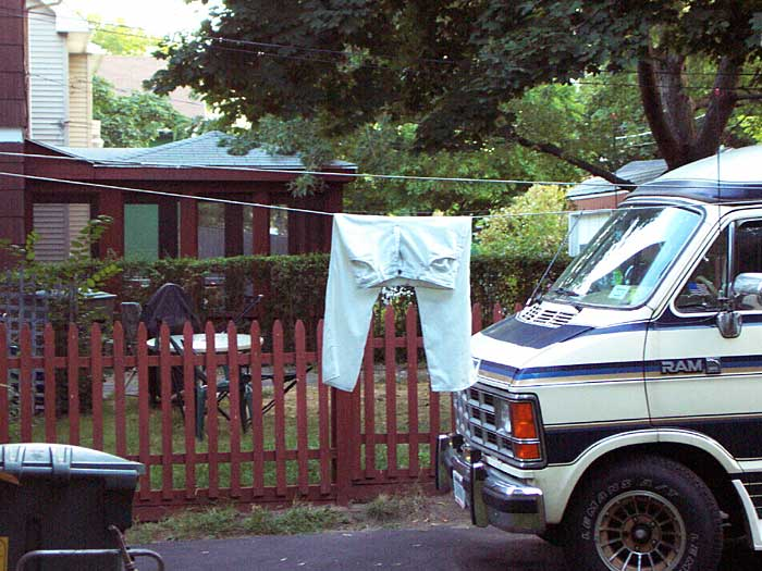 Sparky washes his white pants and hangs them on the line out back.