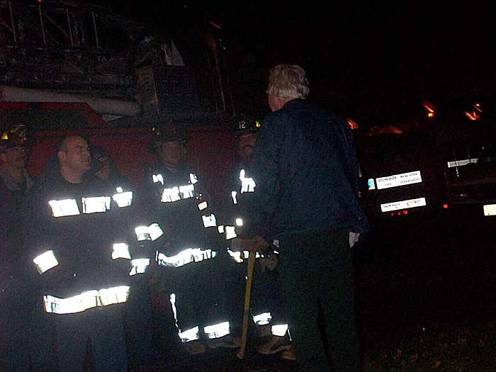 Sparky entertains the firemen out in front of his house. Can't remember why they were called.