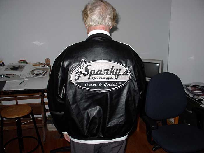 Sparky stops by our new place with his Sparky jacket.