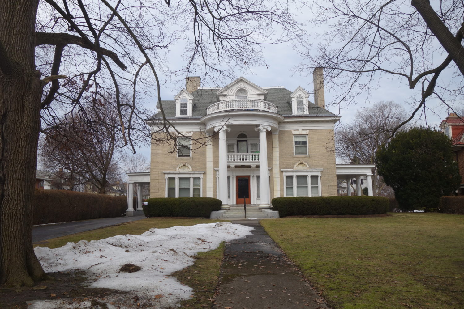 East Avenue home with white columns in Rochester, New York