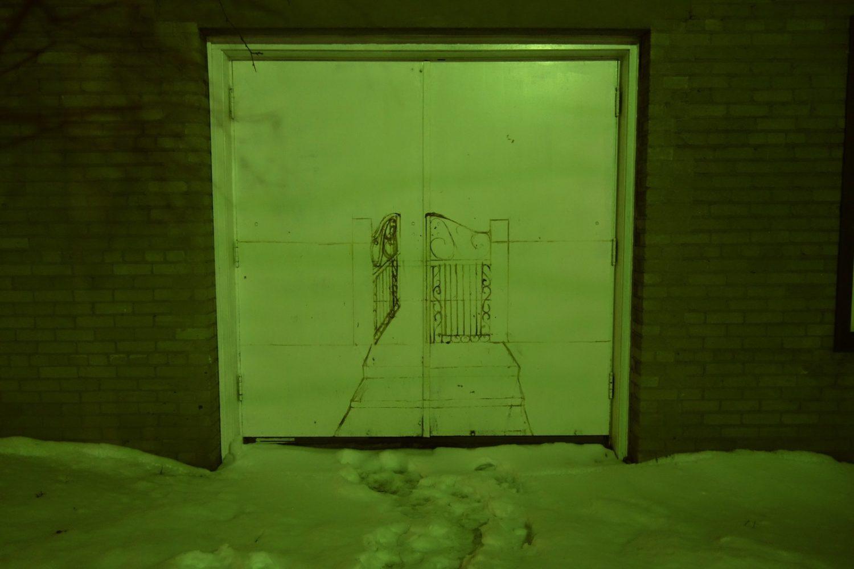Green door being Rochester Contemporary Art Center in winter.