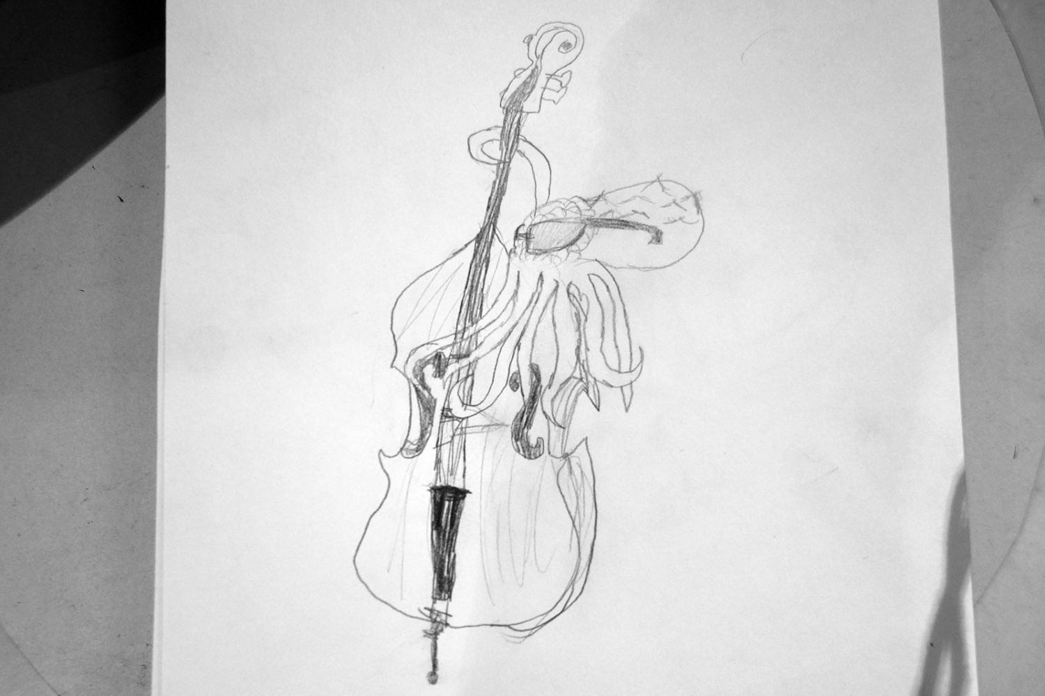 Oscar's drawing of Ken Frank as an octopus playing bass.