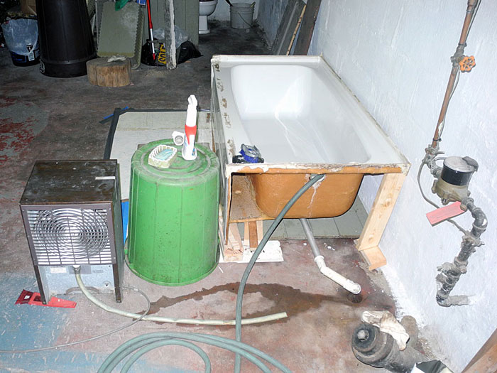 Sparky had his bathroom redone and he set up this temporary bathtub in his basement.
