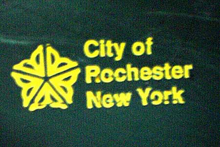 City of Rochester logo on our green trash can.