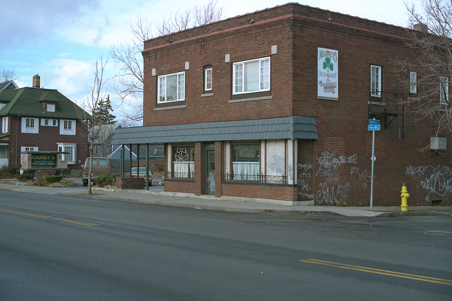 "05. Mooney's, Effinger's, East Main Street, Rochester. Source photo for Paul Dodd ""Passion Play"" 1999."