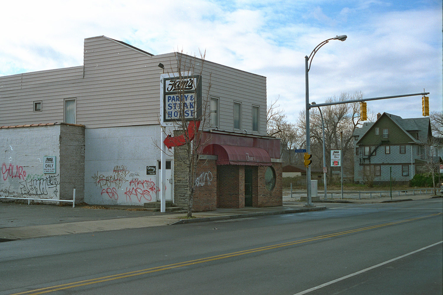 "06. Fam's Party House, East Main Street, Rochester. Source photo for Paul Dodd ""Passion Play"" 1999."