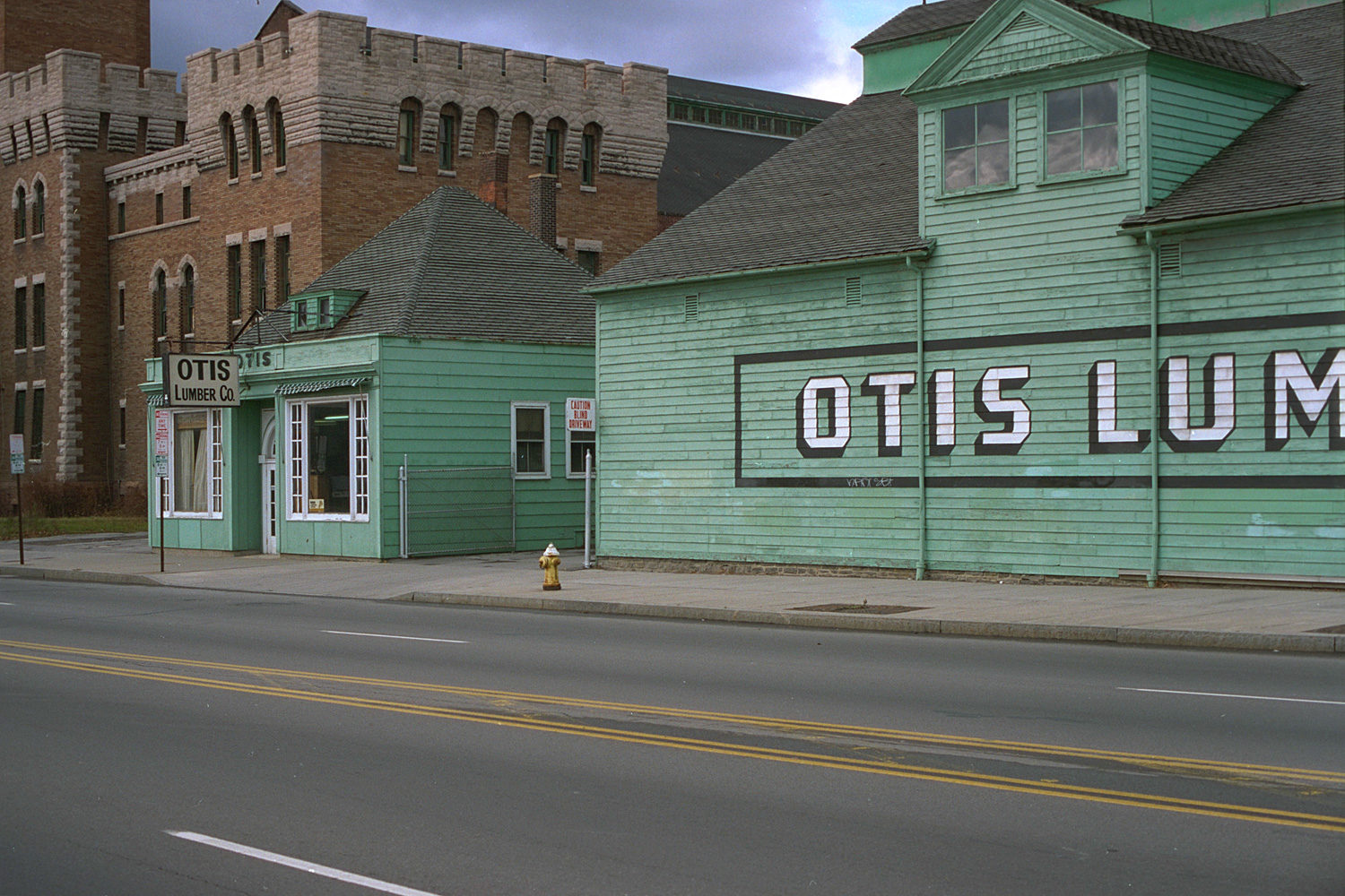 "15. Otis Lumber, East Main Street, Rochester. Source photo for Paul Dodd ""Passion Play"" 1999."