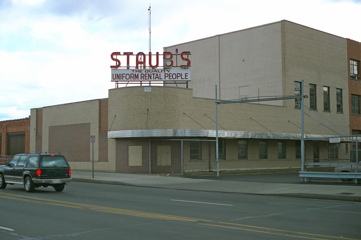 "20. Staub's Cleaners, East Main Street, Rochester. Source photo for Paul Dodd ""Passion Play"" 1999."