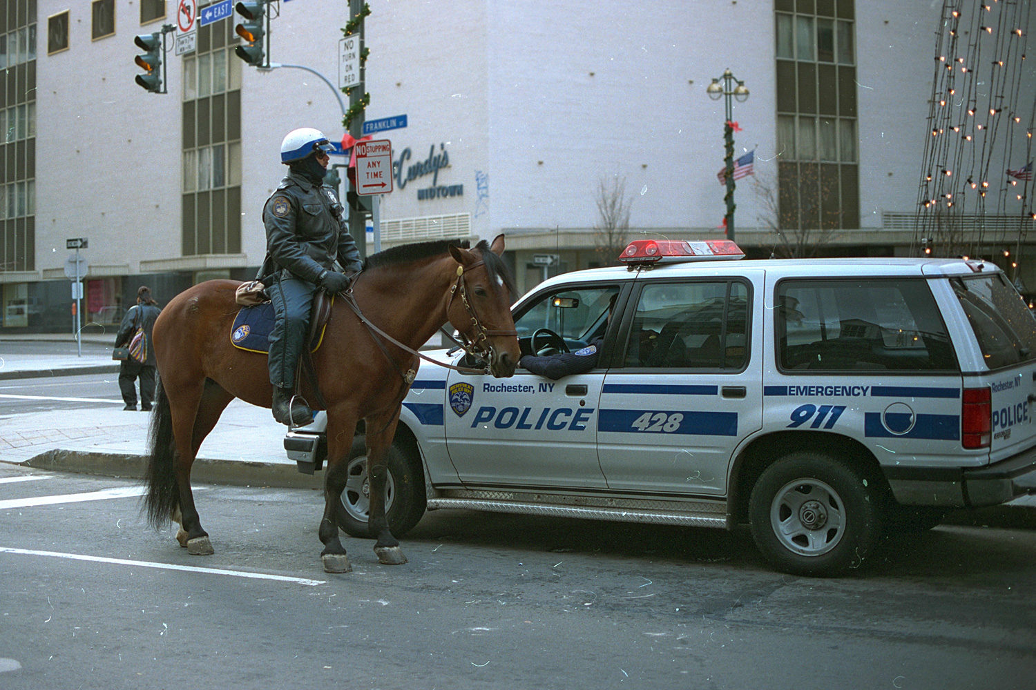 "36. Mounted police near Midtown Rochester. Source photos for Paul Dodd ""Passion Play"" 1999."