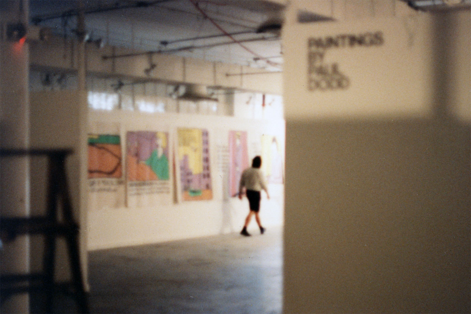 "Installation view of Paul Dodd ""World Record Holders"" 1989 Pyramid Arts Center. Director, Larry Champoux in foreground."