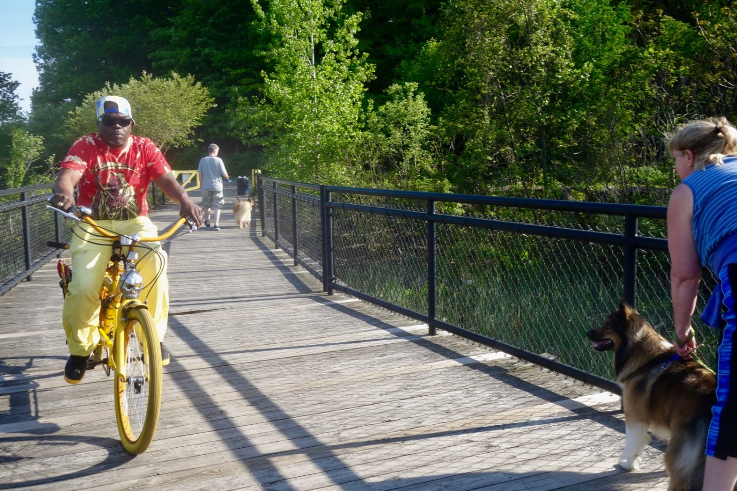 Man on yellow bike at Turning Point Park in Rochester, New York