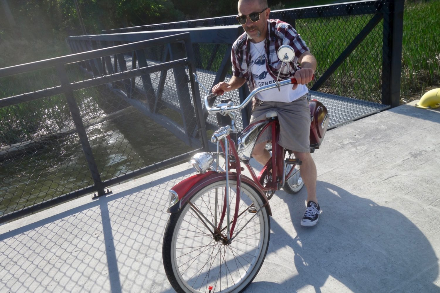 Man on red bicycle listening to Righteous Brothers at Turning Point Park in Rochester, New York