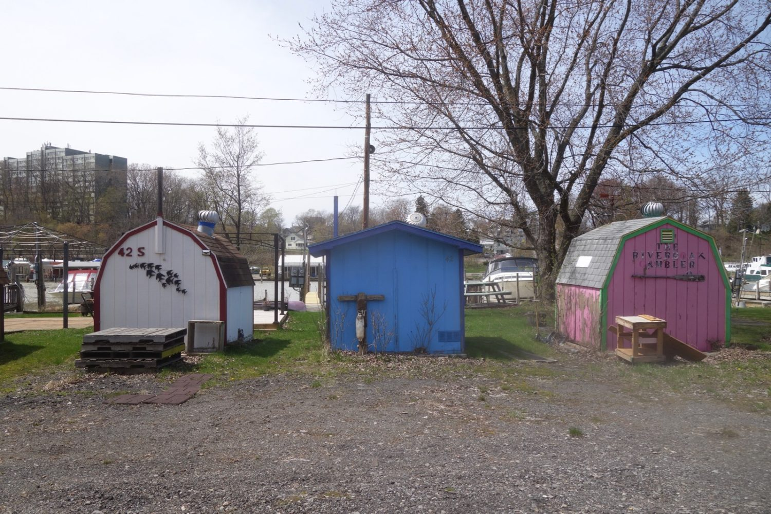 Three small boat houses on Genesee River