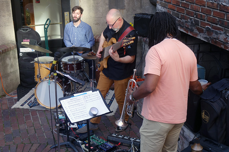 Trio on Belgium Beer place patio performing at the 2018 Rochester International Jazz Festival