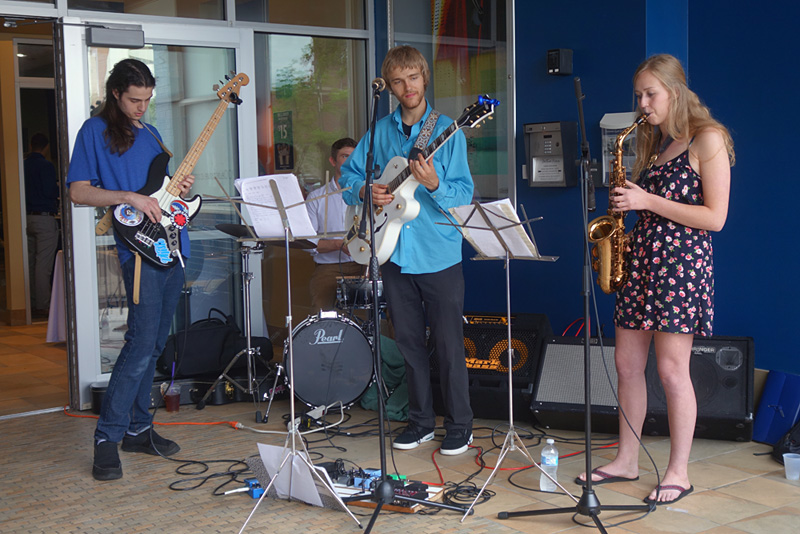 Young trio in front of Spot Coffee performing at the 2018 Rochester International Jazz Festival