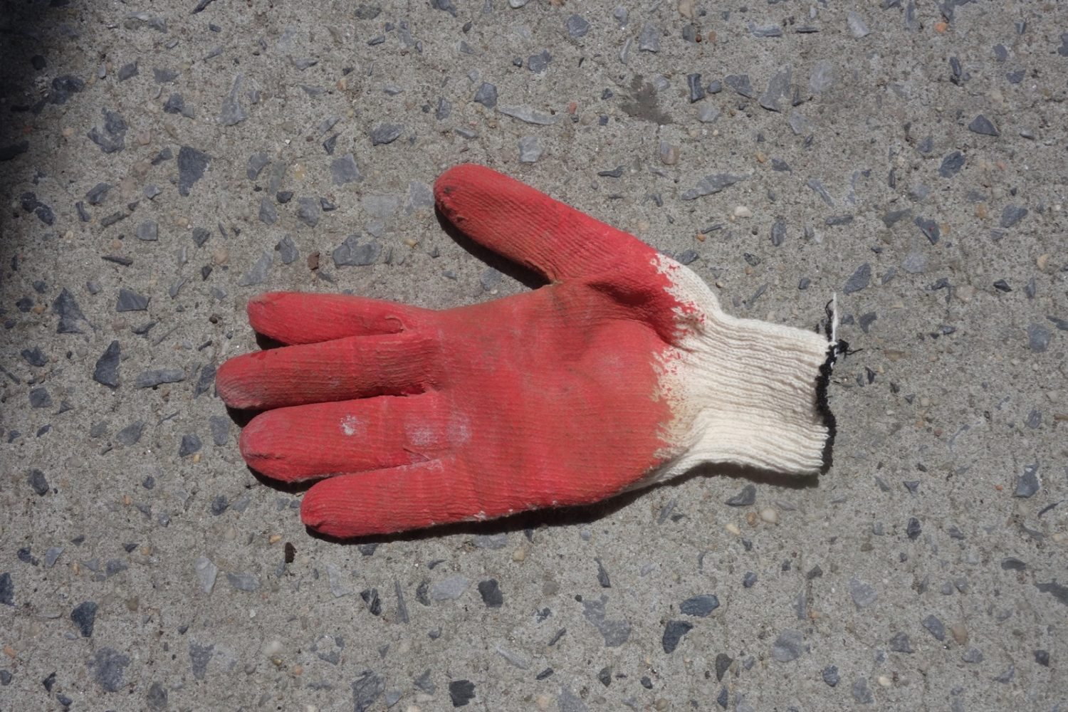 Red glove on the street in lower Manhattan