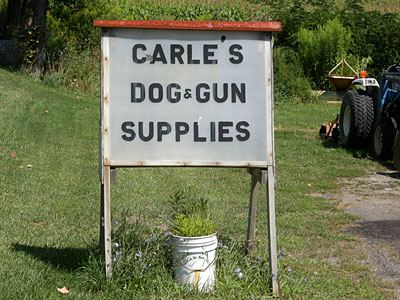 Carle Dog And Gun Sign