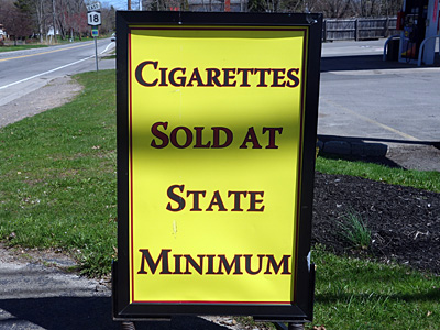 Cigarettes at State Minimum sign