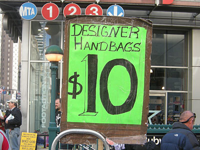 Designer Handbags Sign