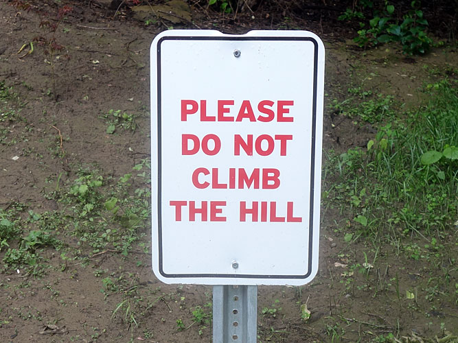 Do Not Climb The Hill sign