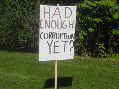 Enough Corruption sign