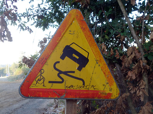 Tire tracks crossing sign