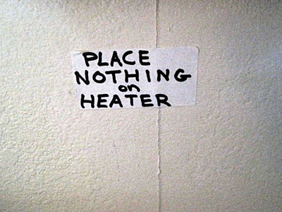 Place Nothing on Heater sign
