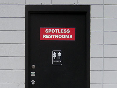 Spotless Restrooms sign