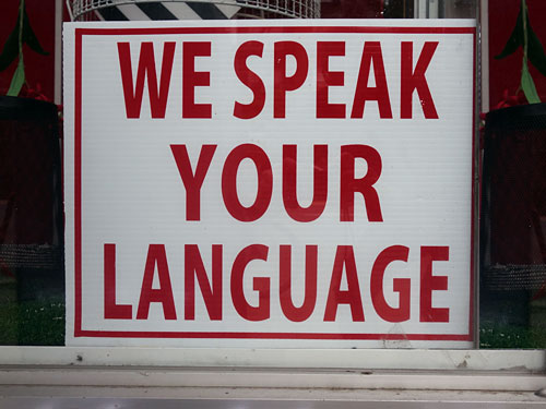 We Speak Your Language sign