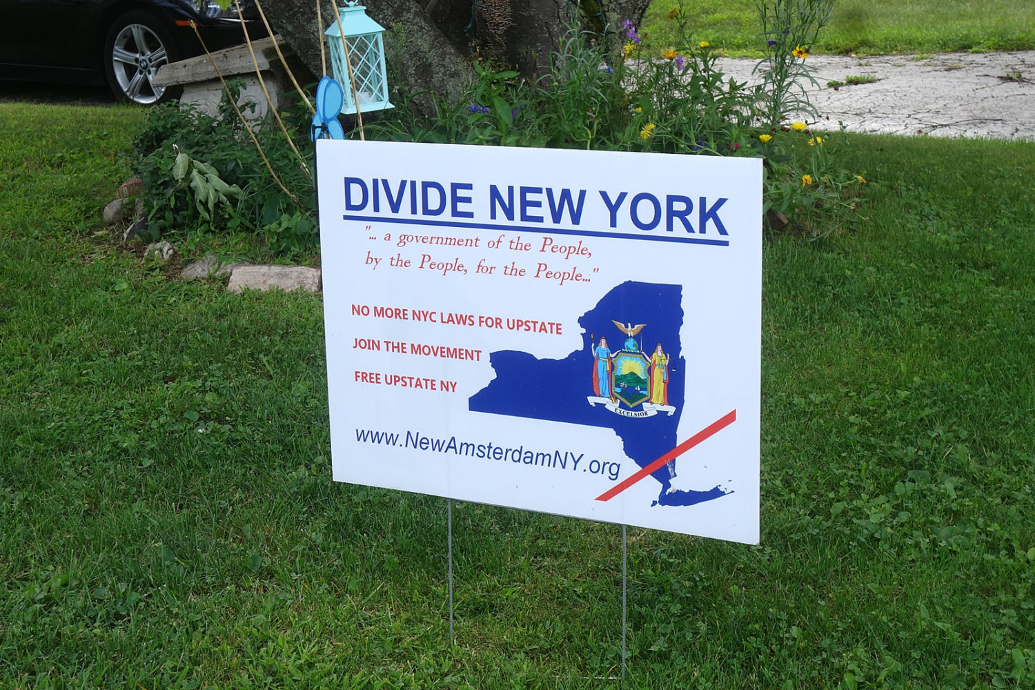 Divide New York sign on lawn in Sea Breeze neighborhood.