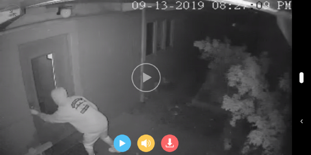 Surveillance hot of kid ringing our neighbor's doorbell