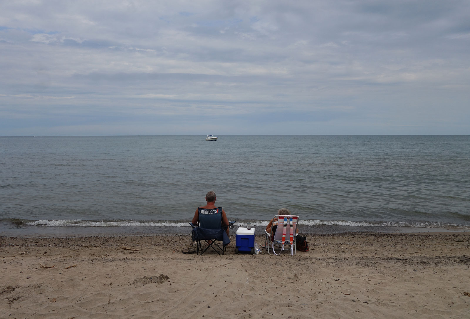 Two people  with cooler at Durand Eastman Beach