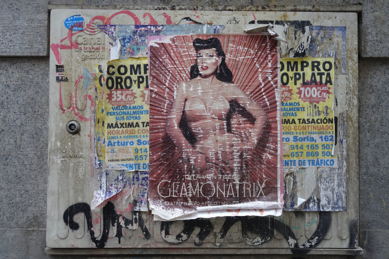 What's left of a poster on the the streets of Madrid.