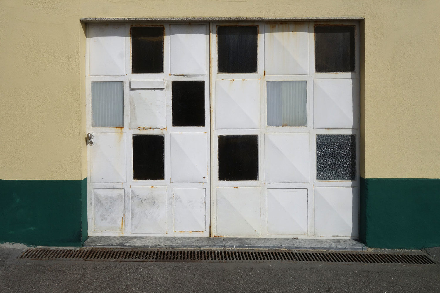 Checkered garage door along Portugal Coast