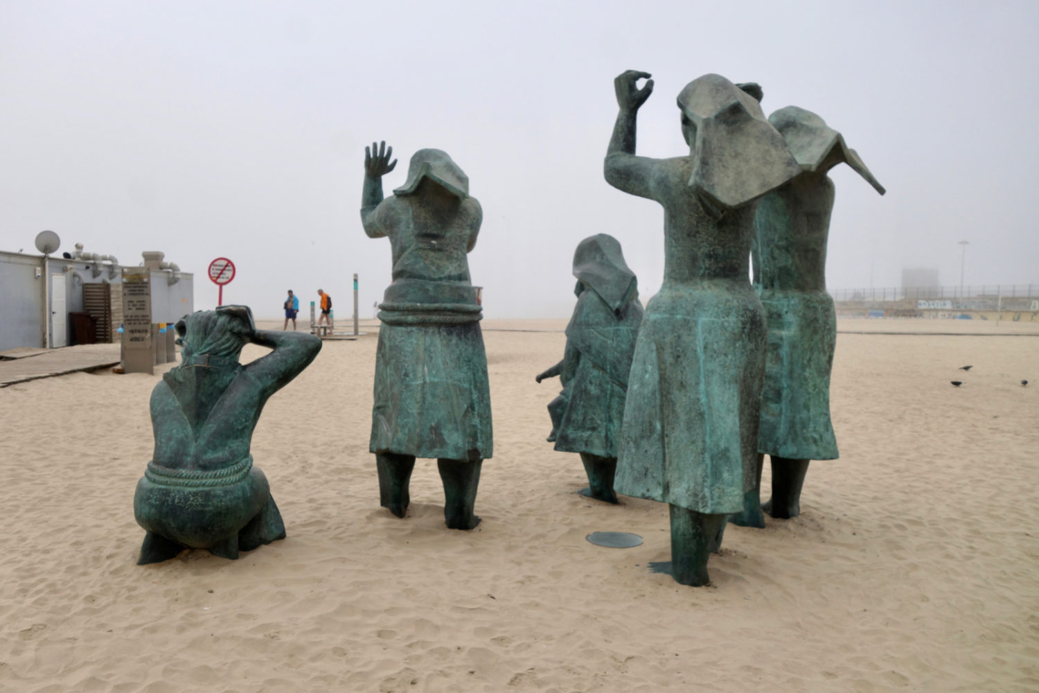 Statues of fishermen's wives along beach in Porto