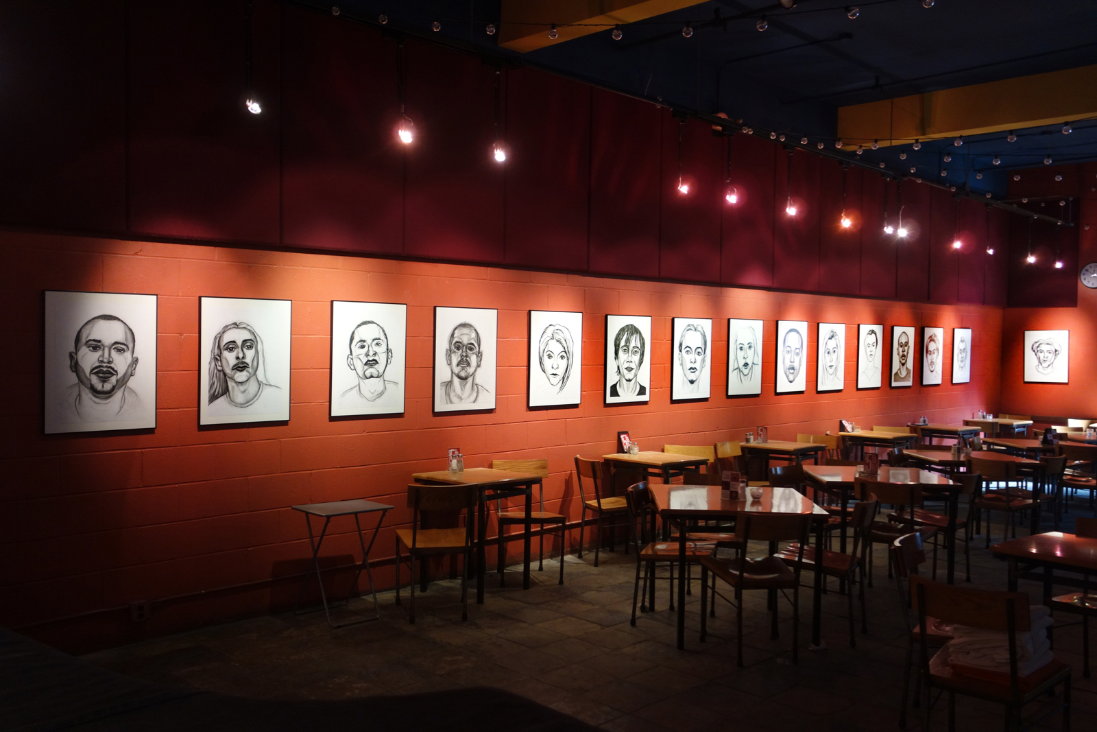 "Installation shot of 15 Paul Dodd ""Models From Crime Page"" at Little Theater Café 2015 18""x 24"" charcoal on paper"