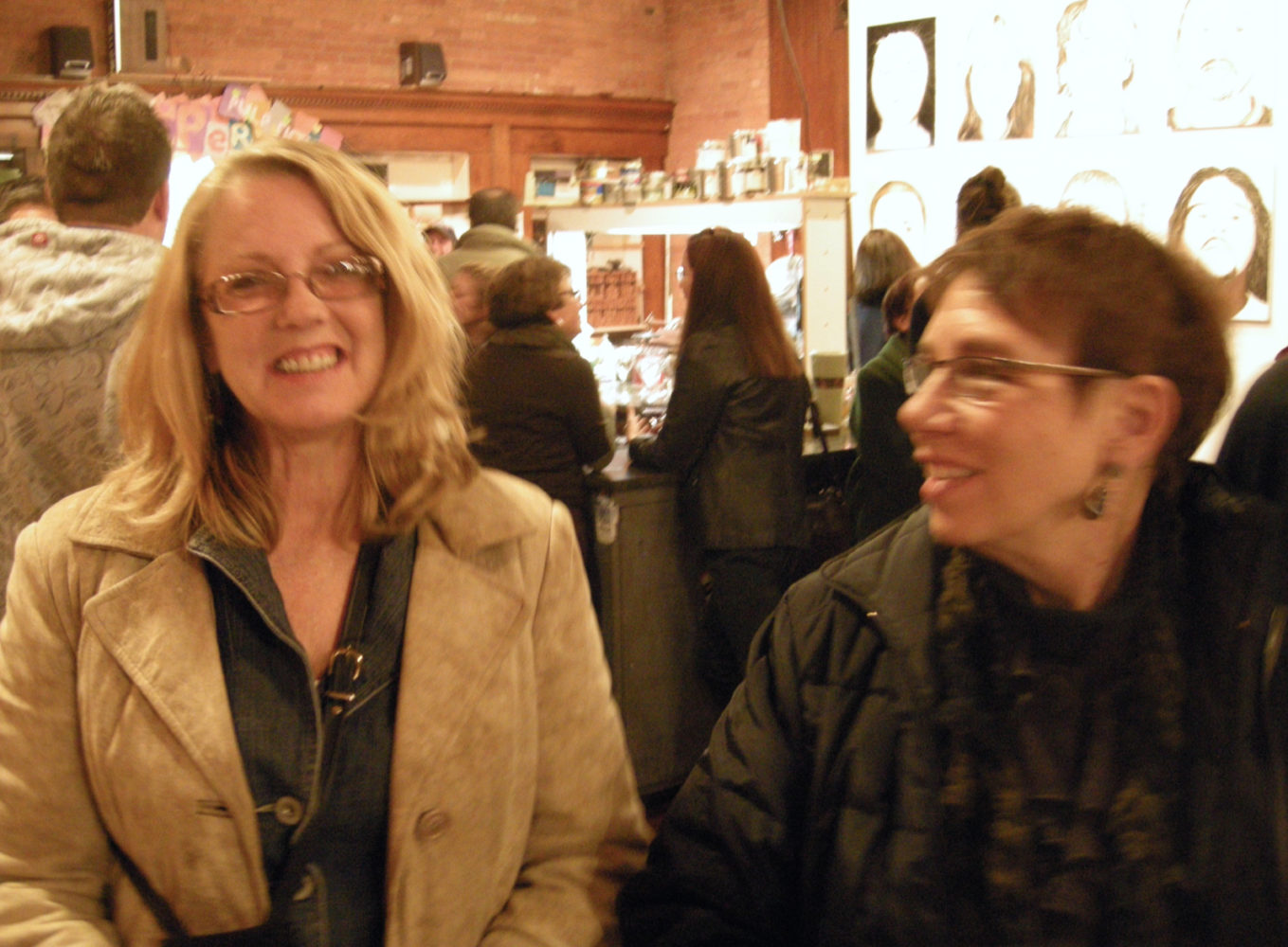 "Carol Heveron and Anne Havens at opening of Paul Dodd ""Local Crime Faces 2009"" at Printing Book Arts Center 2009"