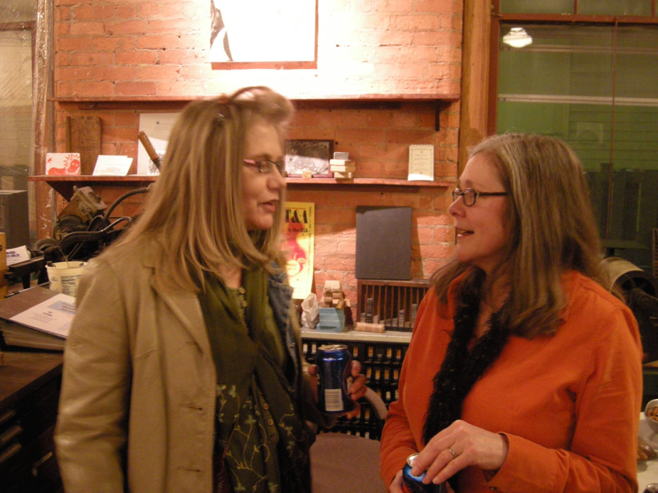 "Janet Williams and Peggi Fournier at opening of Paul Dodd ""Local Crime Faces 2009"" at Printing Book Arts Center 2009"